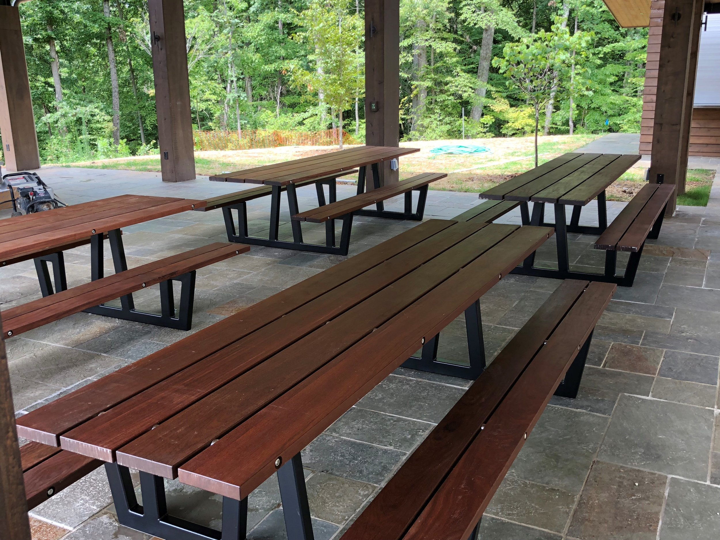 Solid Ipe (Brazilian walnut) and metal pic nic tables at Clayton Homes Headquarters.