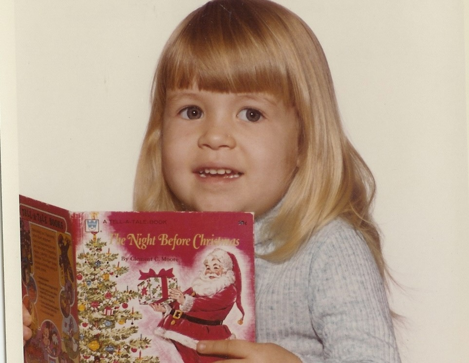 Traci already in love with books at age two!