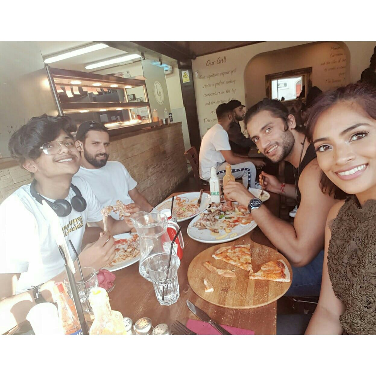 - Ending the shoot with yummy food at Manjaros with the crew