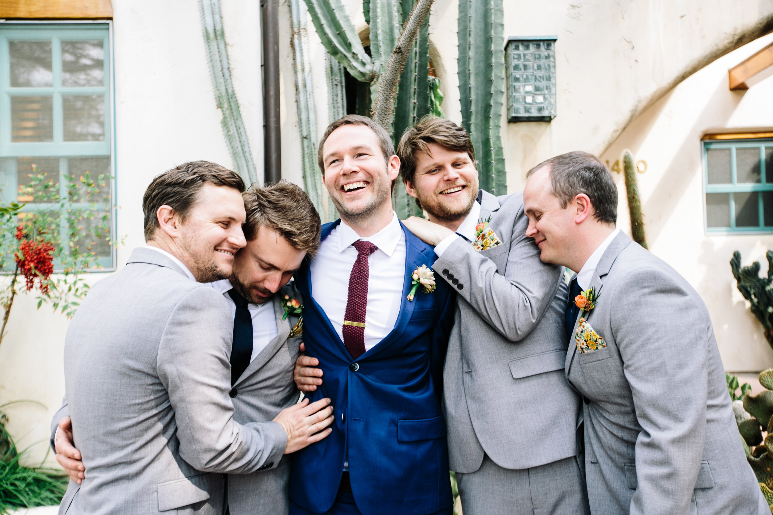groomsmen have a snuggle moment