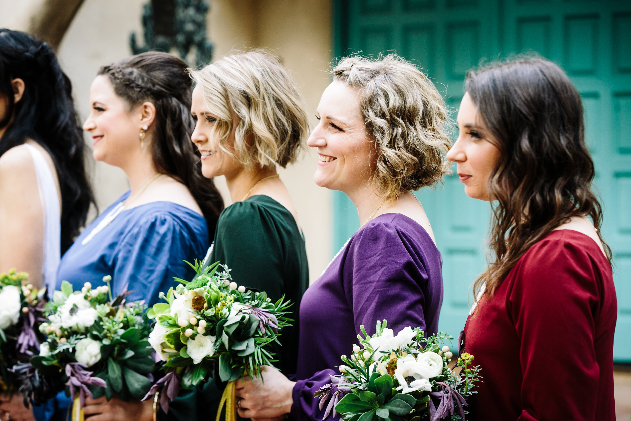bridesmaids hold bouquet