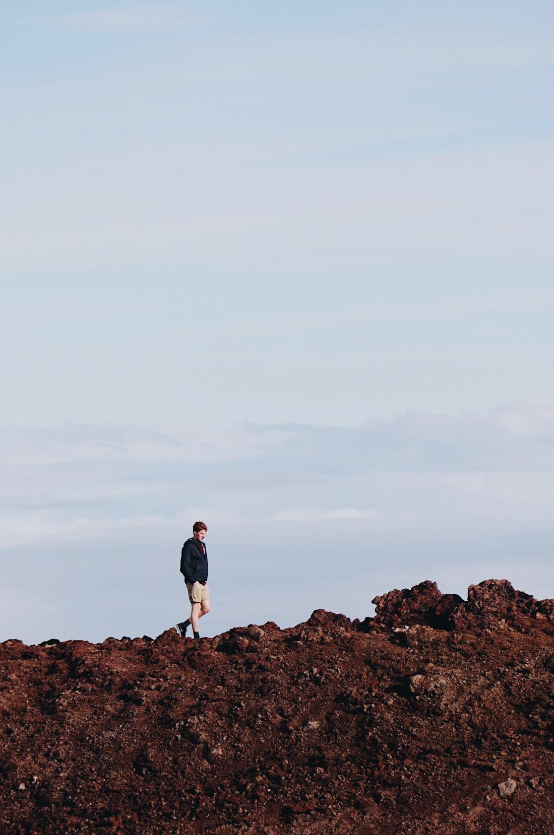 Austin Cody walks along a rocky trail in Haleakalā National Park