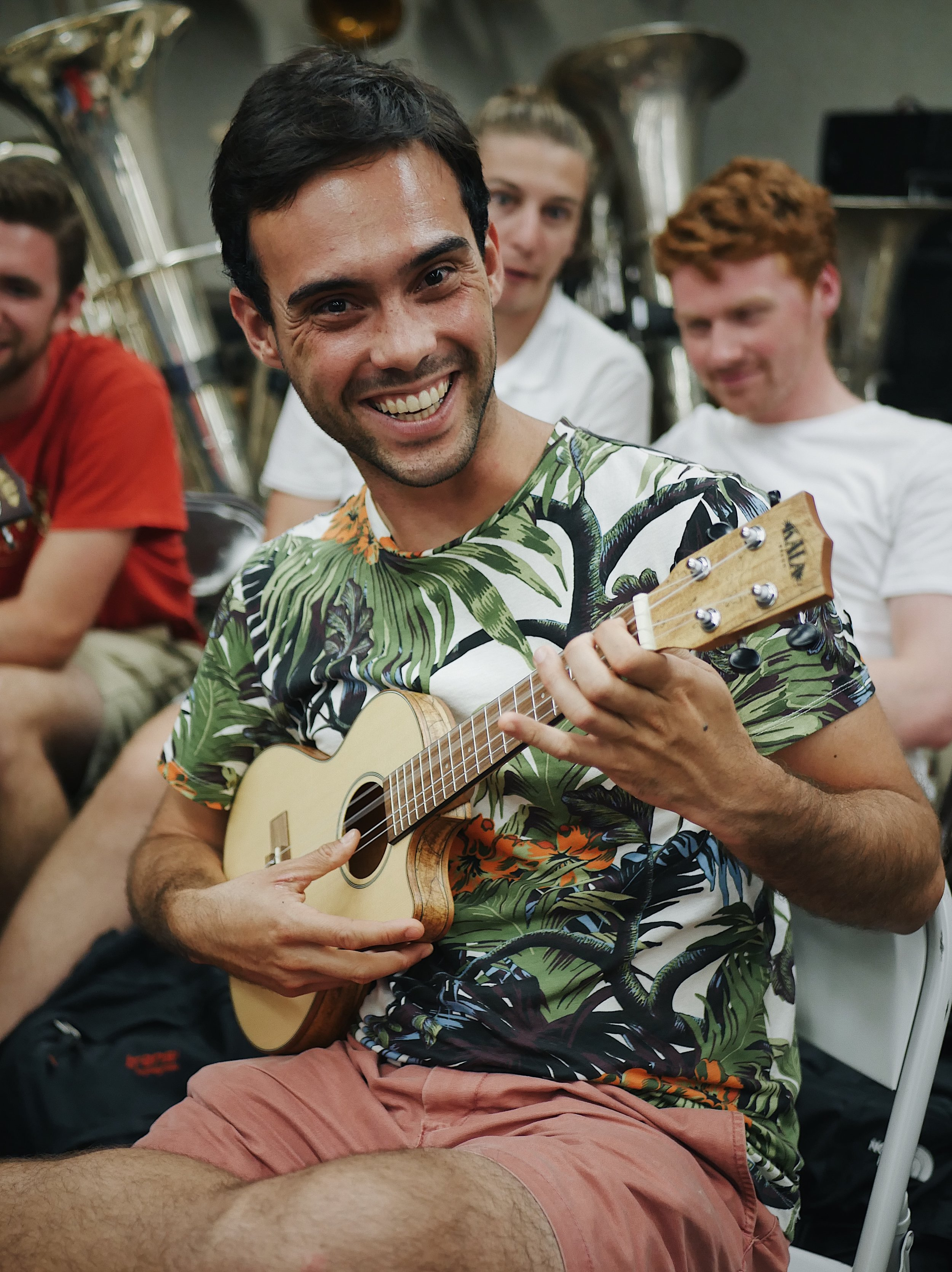 Patrick Braga tests out his 'ukulele skills after a rehearsal with the MCO and Chorus