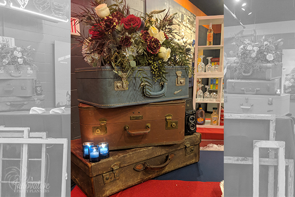 Cocktail Bar Suitcase and Flowers_1940s Themed Decor_InnovativePartyPlanners2018.jpg