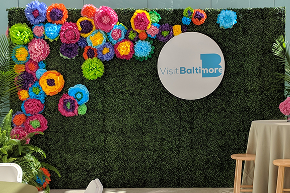 Photo backdrops are a great way to publicize your brand. Guests pose infront of the custom backdrop, post their photo on social media, and your brand hits the internet. Be sure to communicate your event hashtag and upload a snapchat filter.