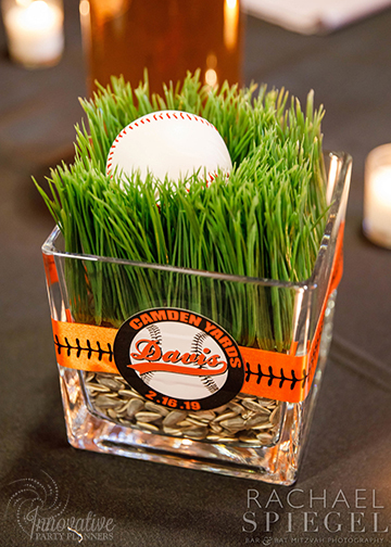 Bar Mitzvah Camden Yards_2-16-19_Long Table_Rye Grass w Baseball and stiching Centerpiece_1.jpg