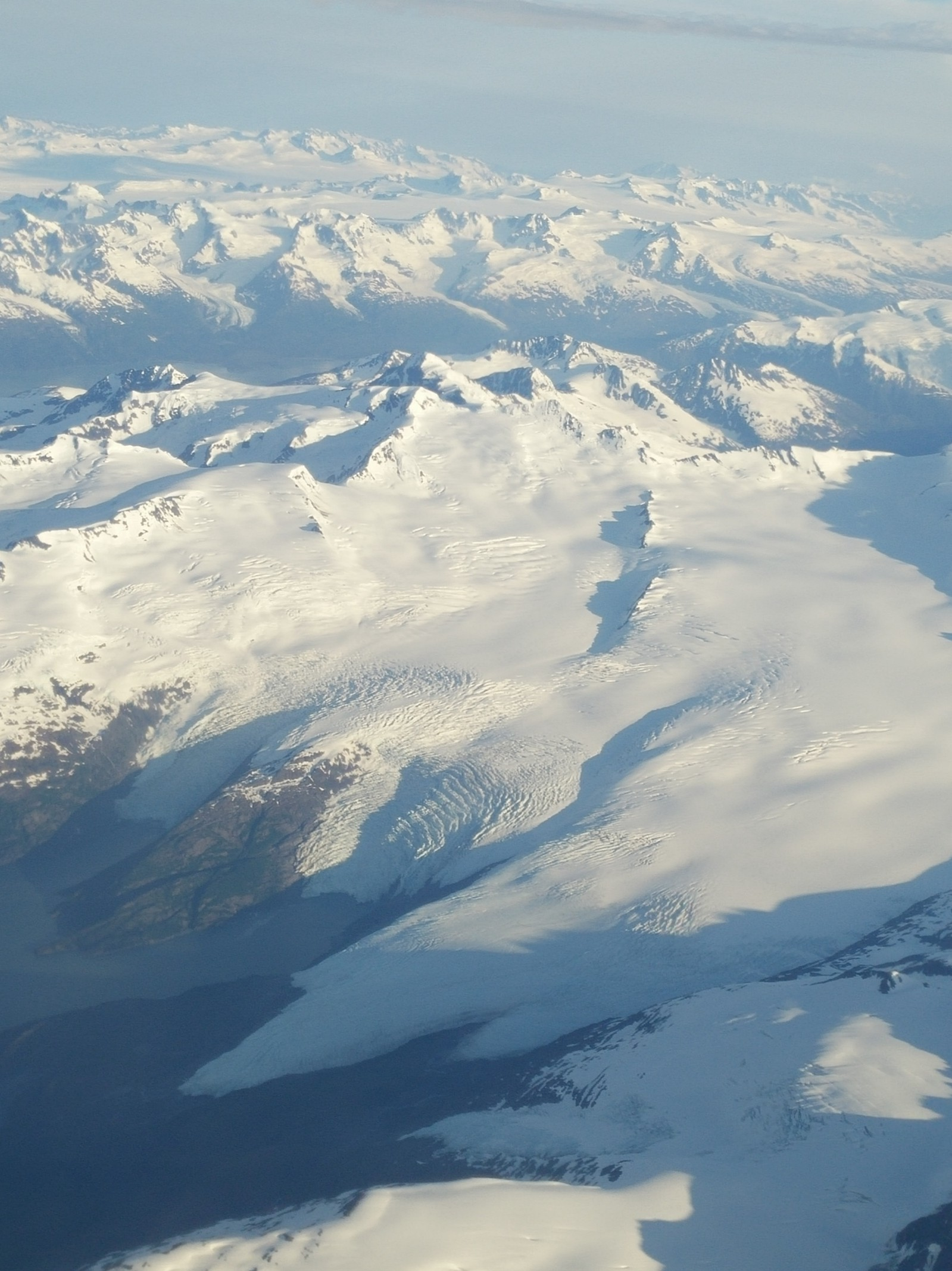 This pitcher of cream spilled over mountain tops is what you see just before you land in Anchorage, Alaska.