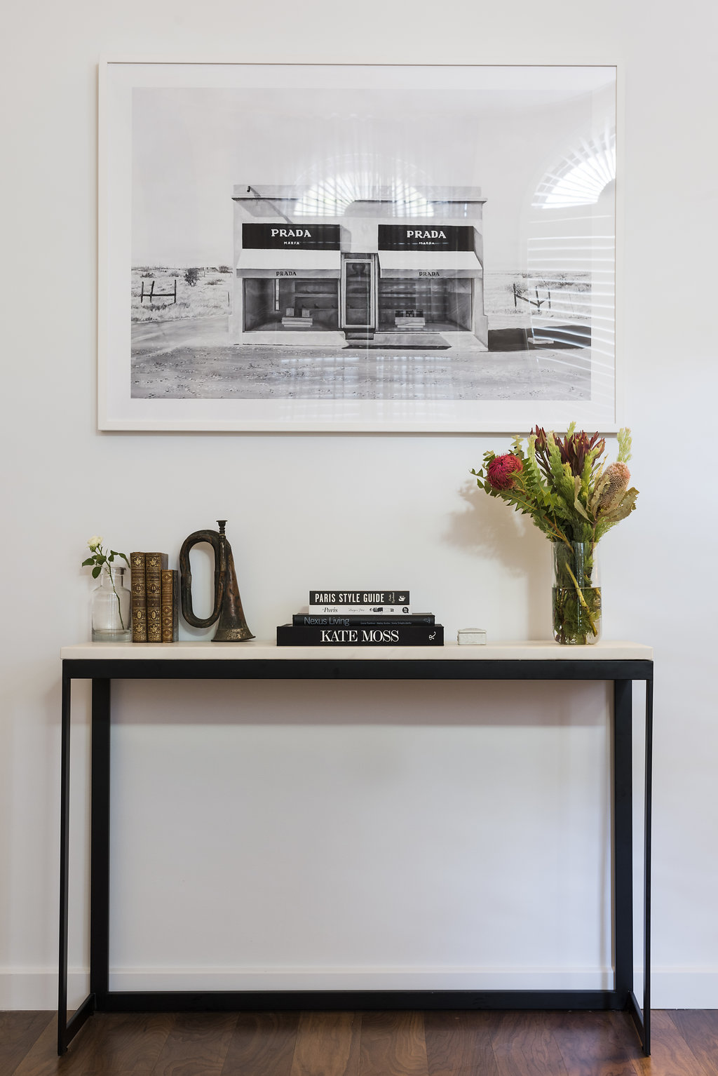 Prada Marfa artwork and a few of Kerrie's favourite finds,including the bugle from a Paris flea market.