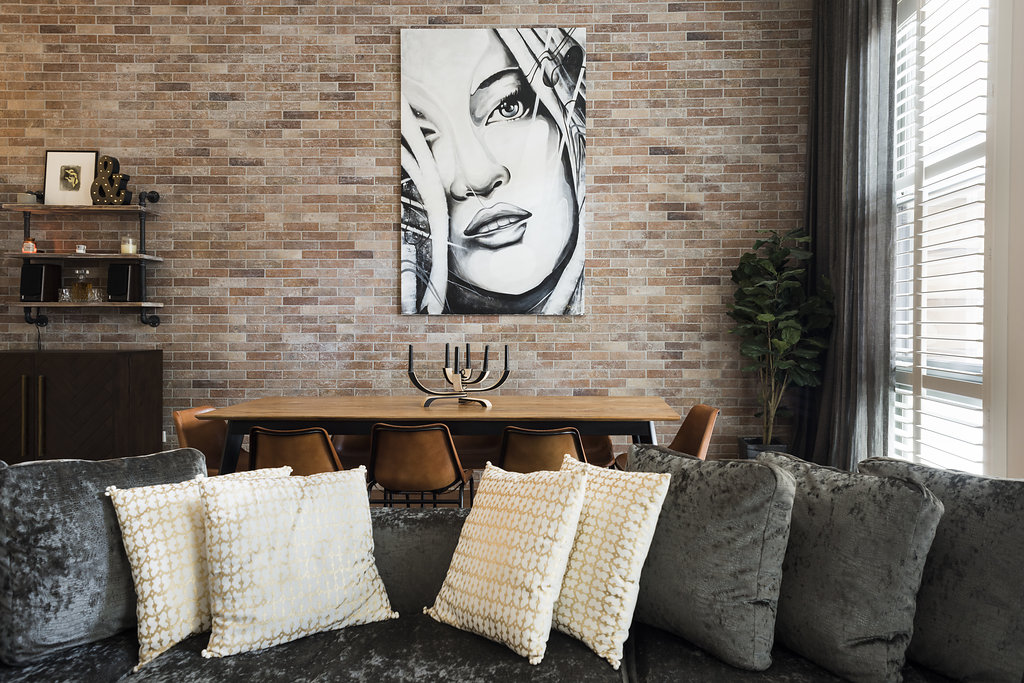 Hey there Kate!  Adam and Kerrie had this artwork of Kate Moss commissioned by a street artist they met overseas. She looks amazing and a perfect feature piece for the apartment.