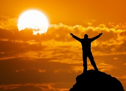 silhouette-of-man-on-mountain-peak-with-arms-outstretched-looking-at-the-sun,2290494.jpg
