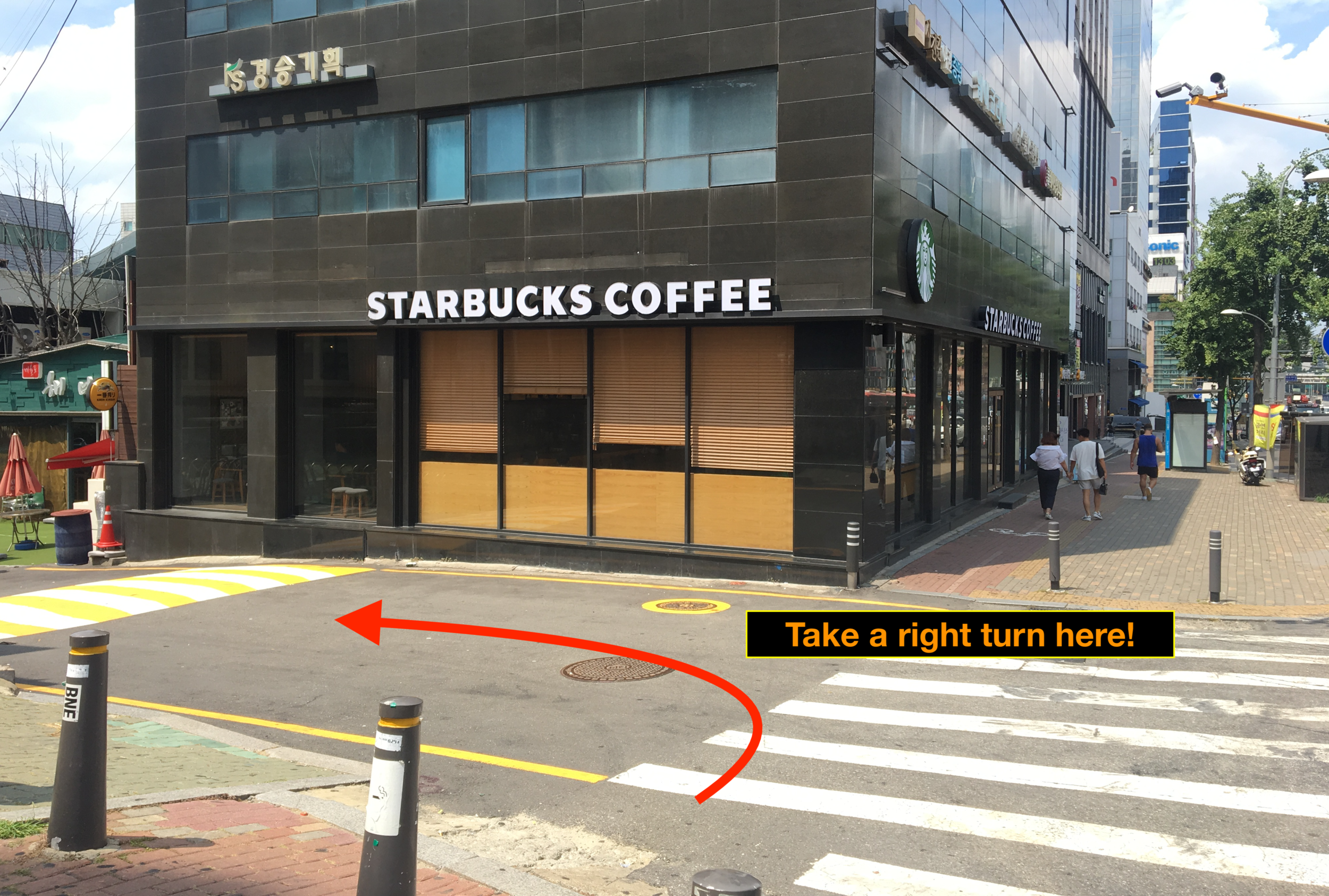 3. Walk down to starbucks and take a left turn. - When you see Starbucks, take a left turn towards holly's coffee for 30 seconds.