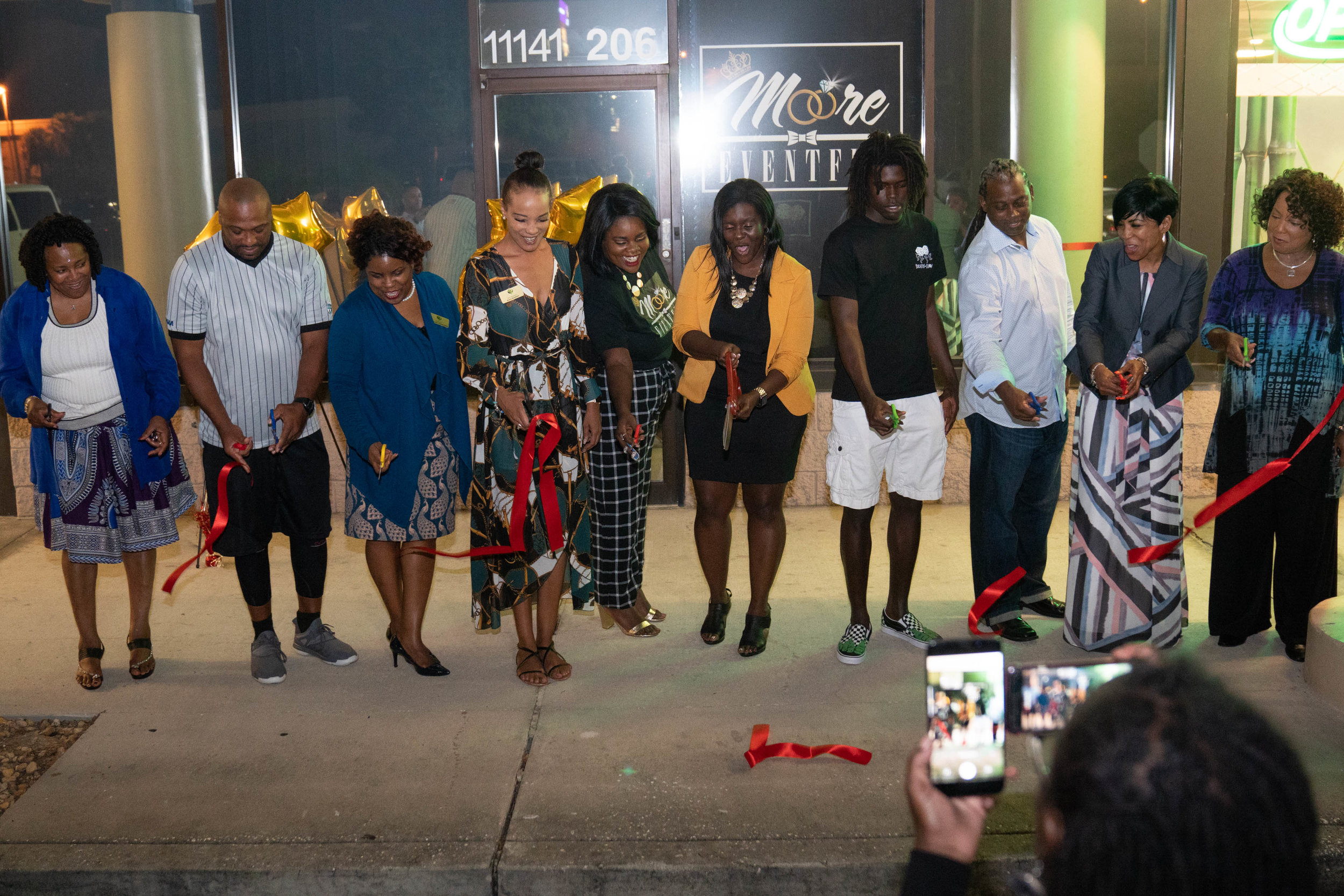 MOORE EVENTFUL RIBBON CUTTING