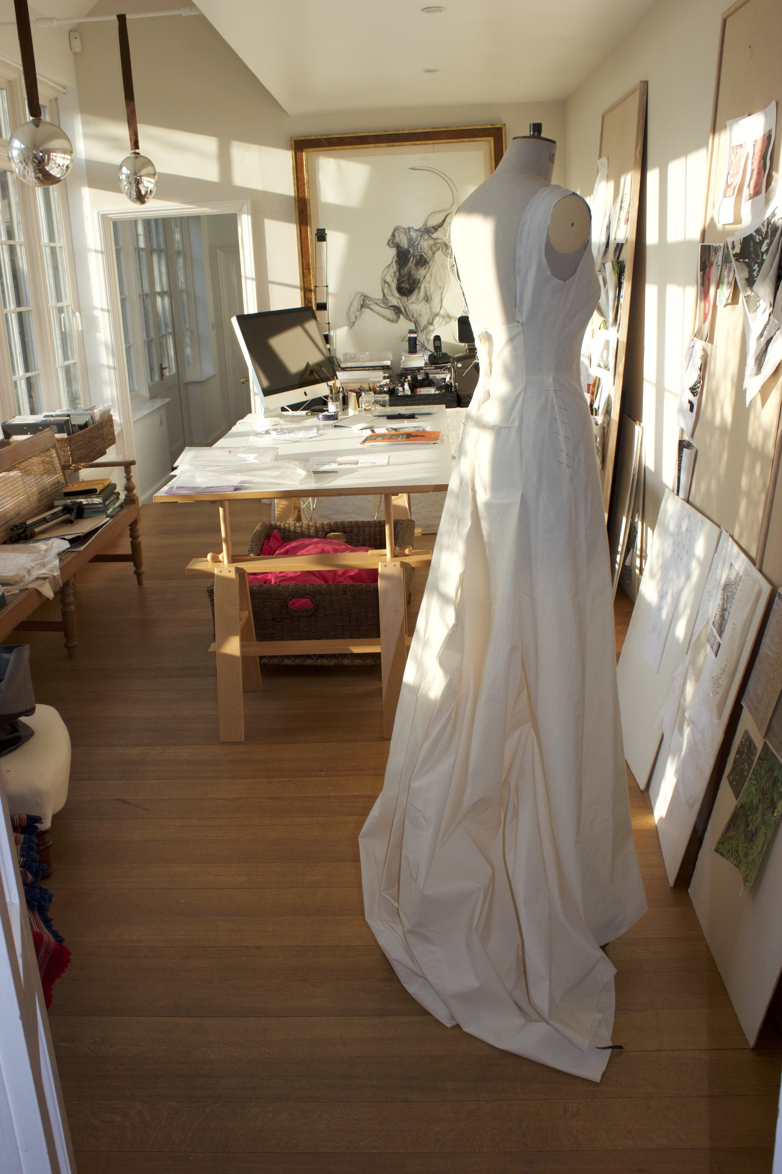 WORKING ON A TOILE IN THE PEACE AND QUIET OF HIS STUDIO OVERLOOKING THE GARDENS