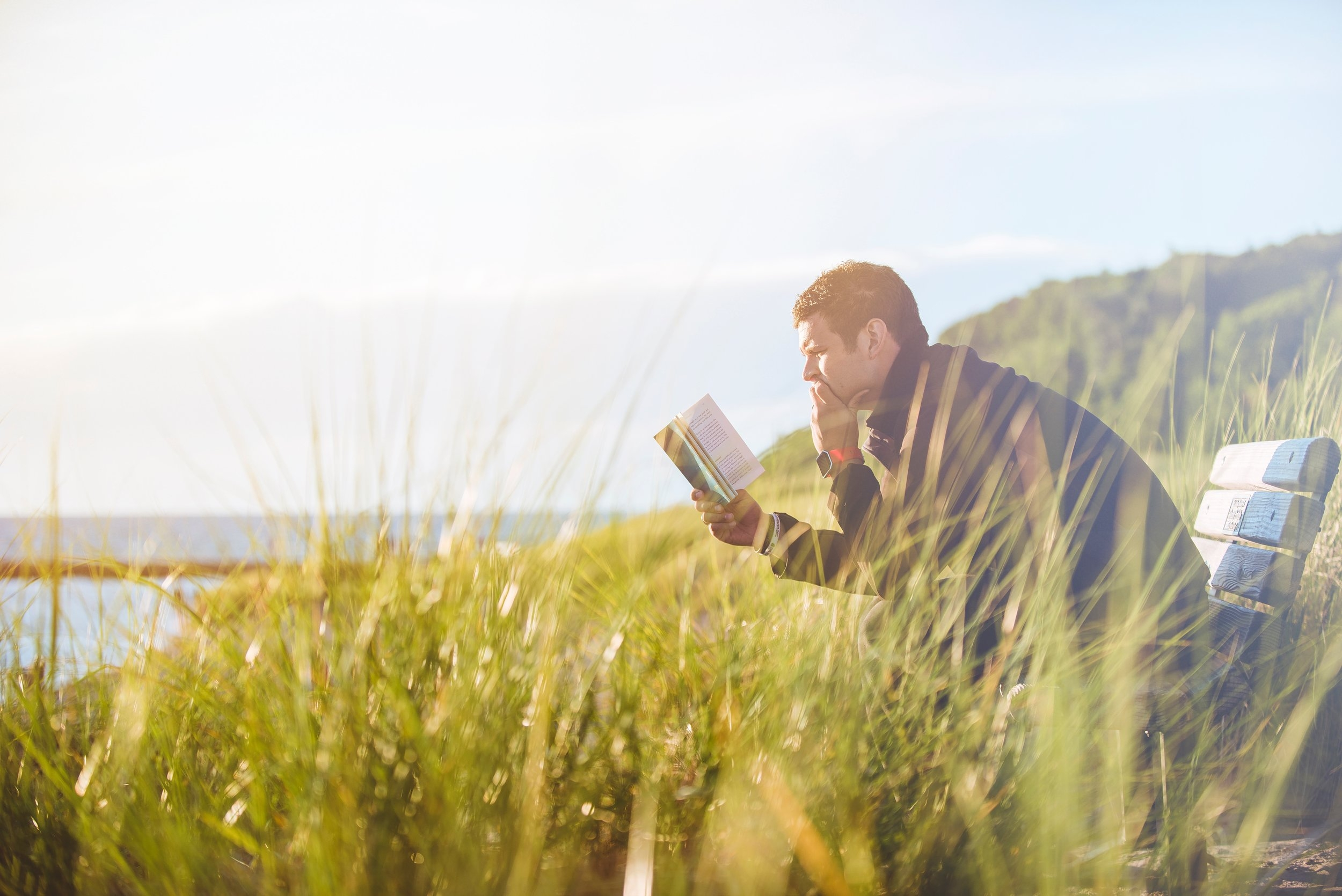 man-reading-book-about-connecting-with-mental-health