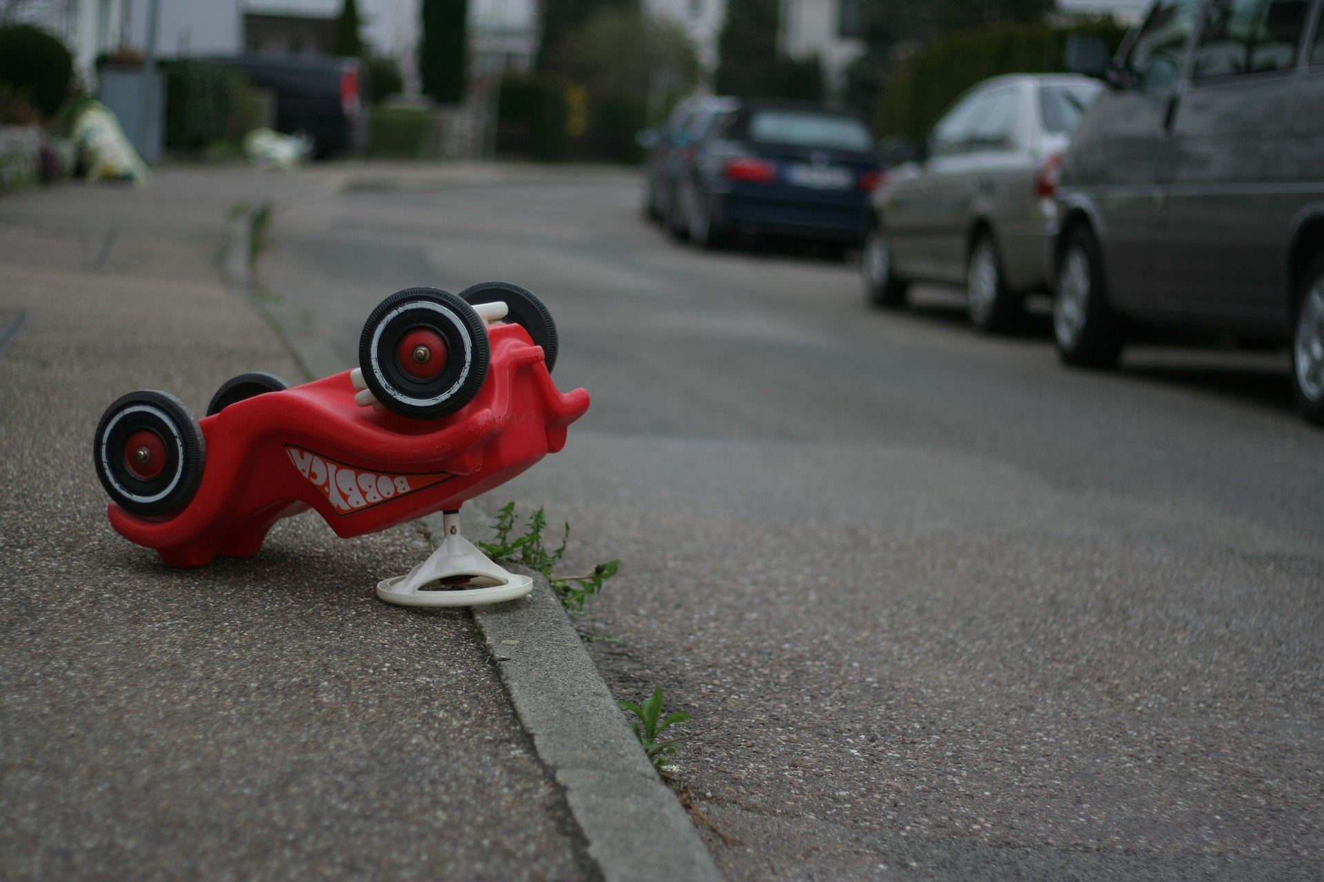red toy truck upside down on street