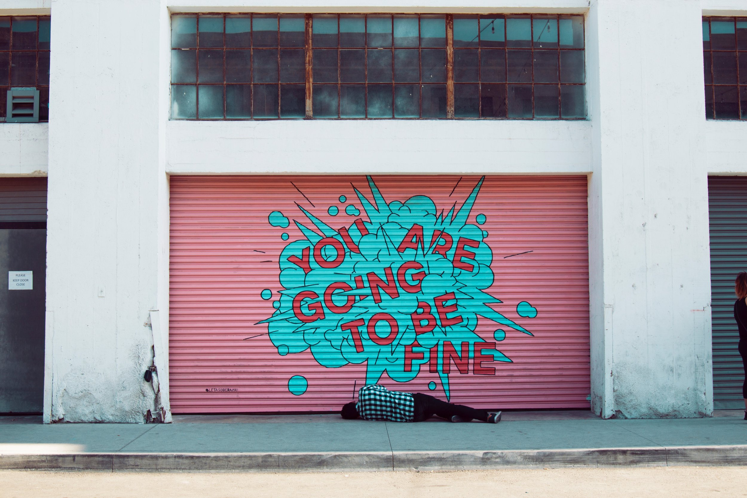 mural painted on garage with the words you are going to be fine