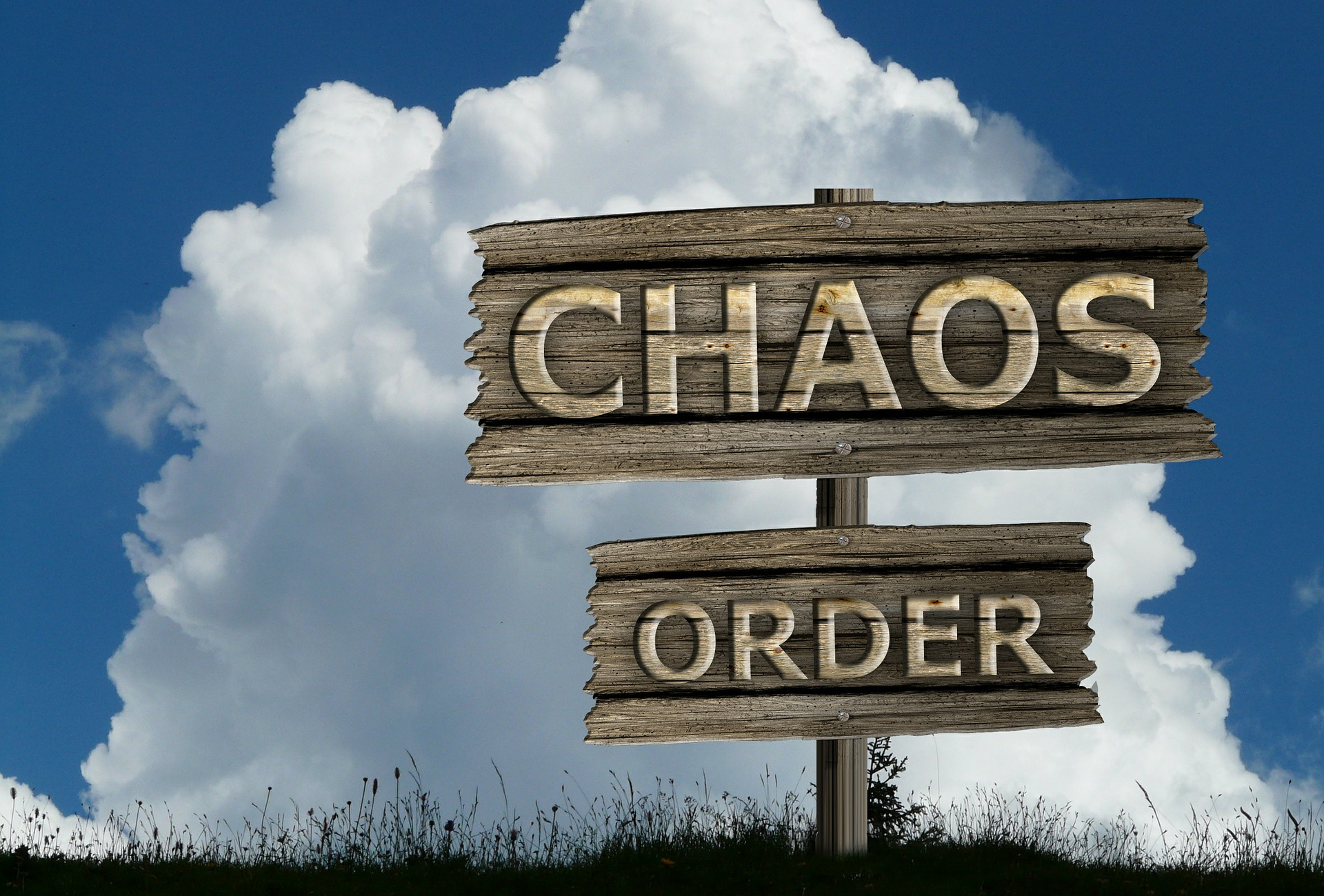 two wooden signs with the words chaos and order
