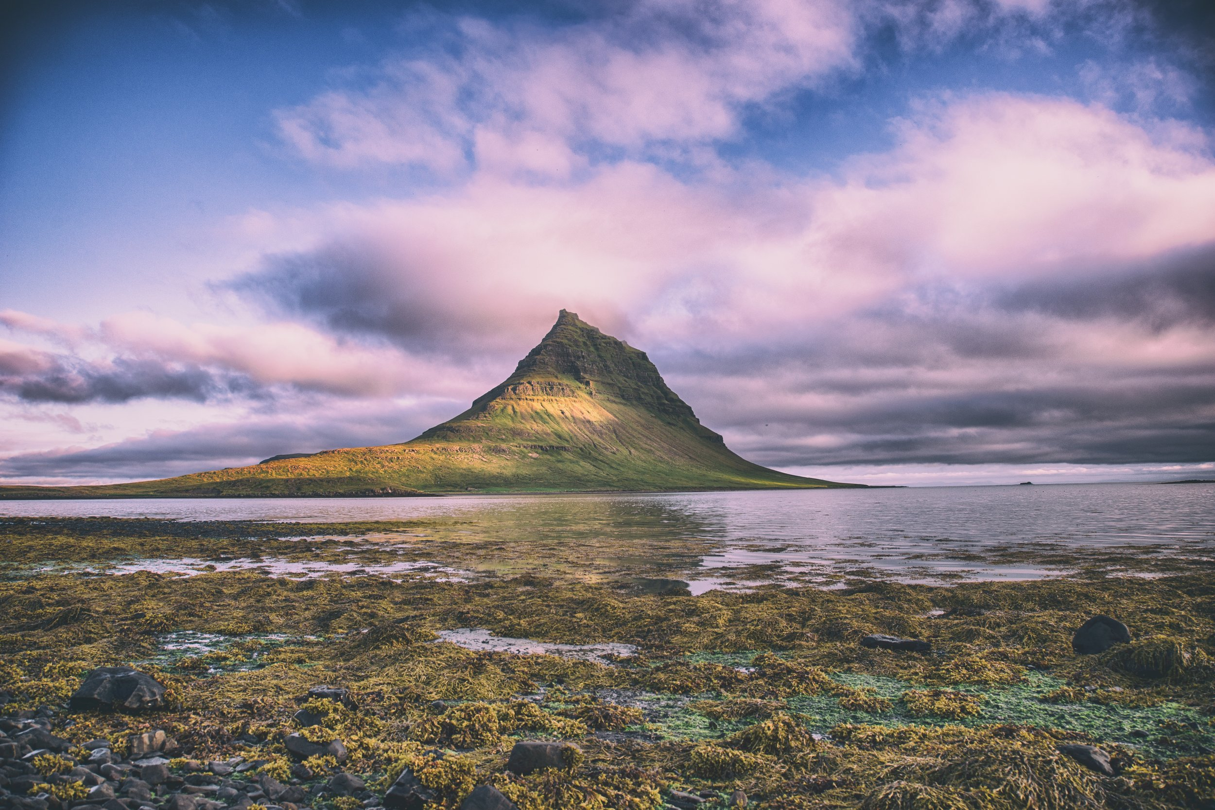 mountain on island with colorful sky