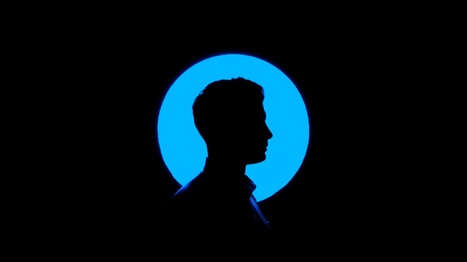 silhouette of man's face in blue circle