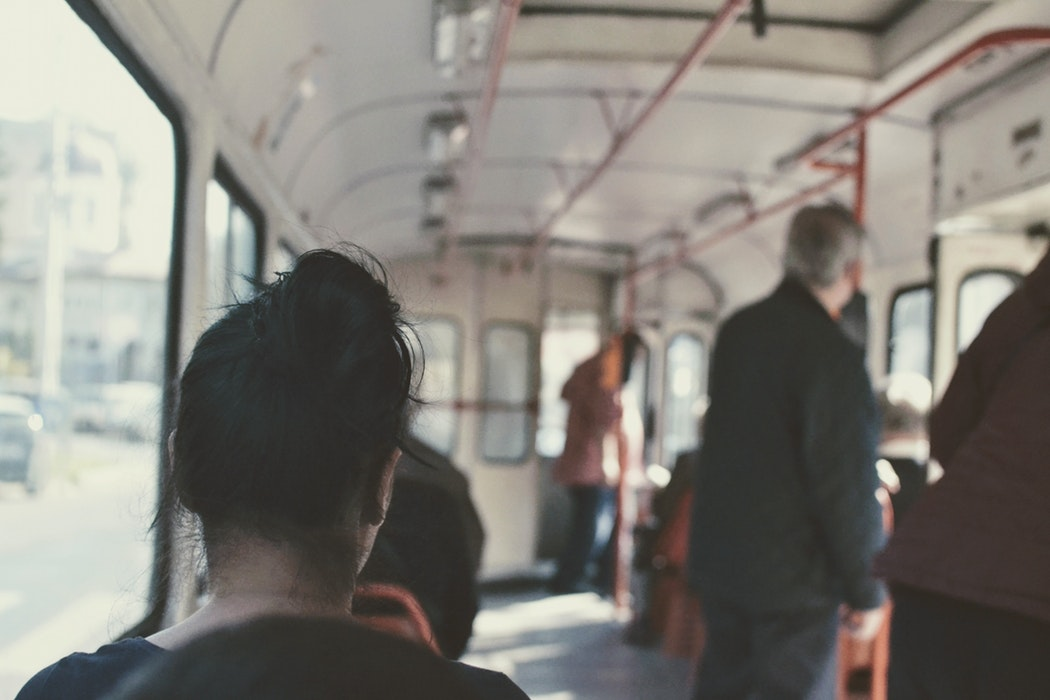 woman with anxiety sitting on train