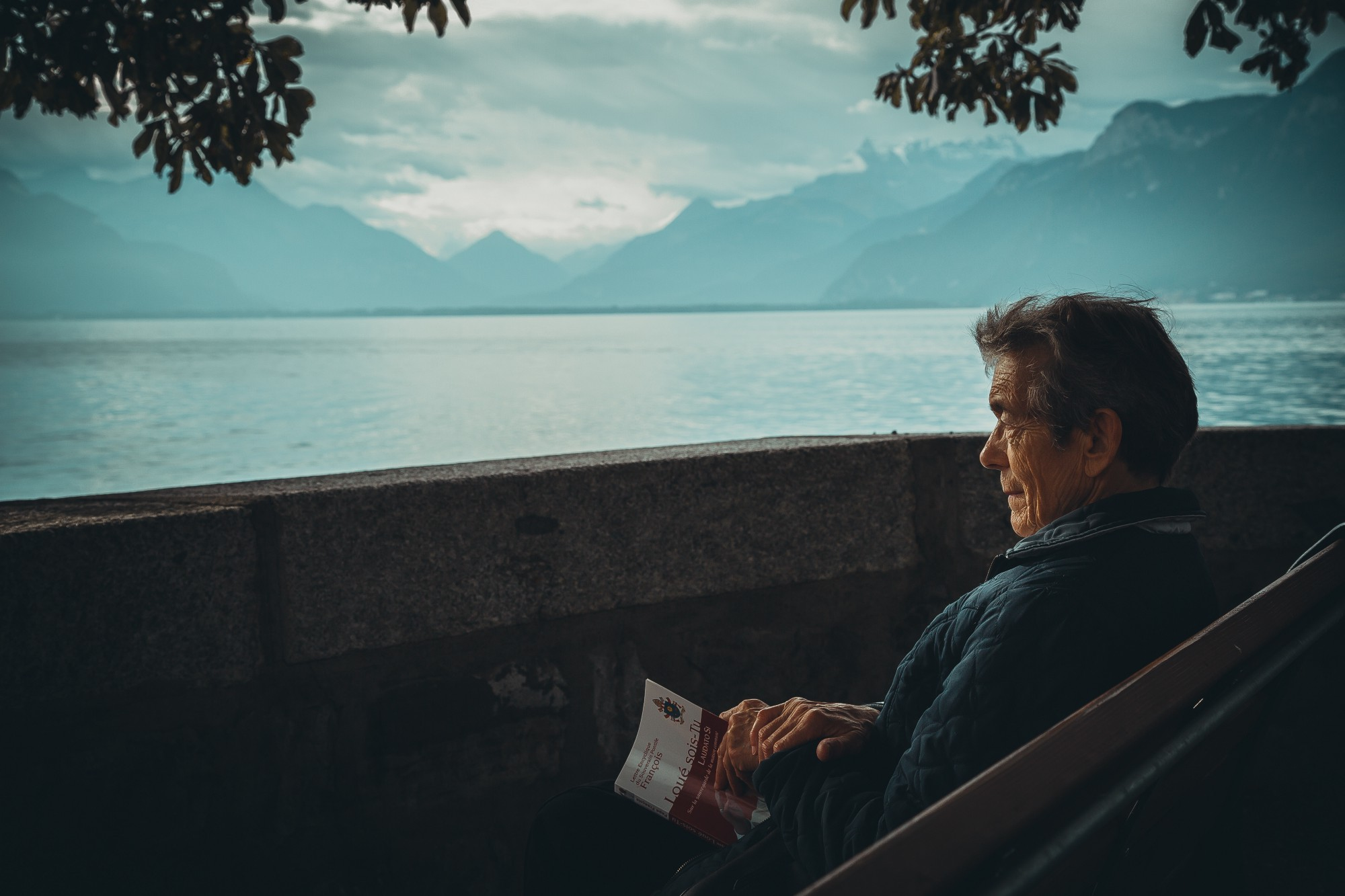 older man thinking while looking out at lake