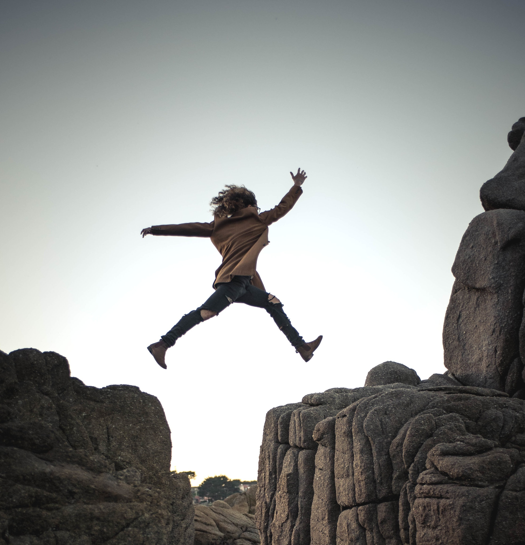 woman jumping to conquer her fear