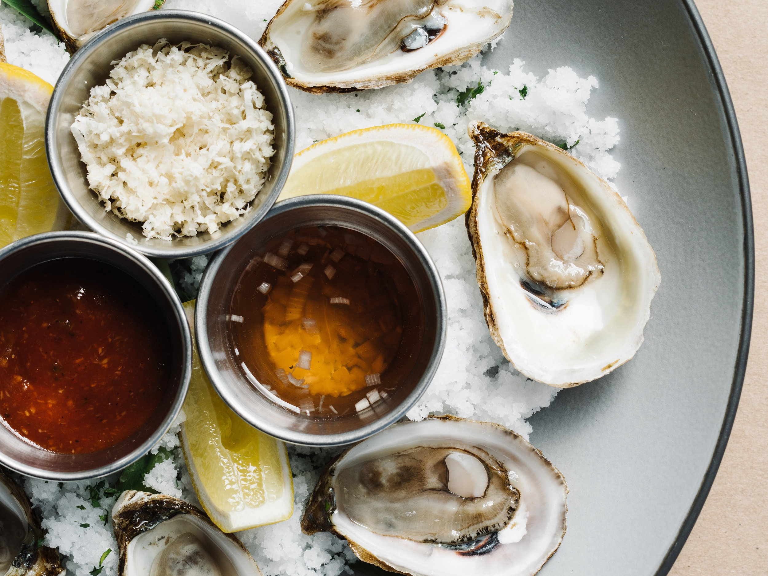 Happy Hour Oysters - Unwind with us after a long workday.Every M-F from 5-7pm, come enjoy $1 oysters!