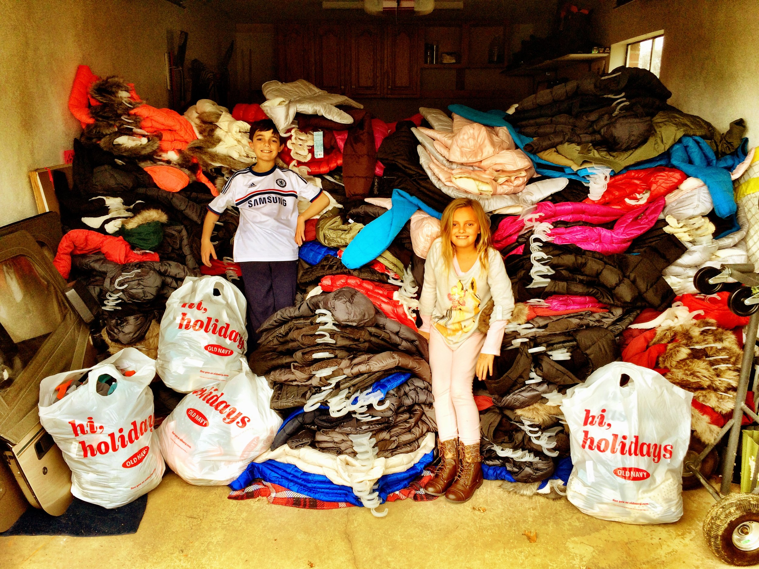 Max and Chloe help unload the truck full of coats.