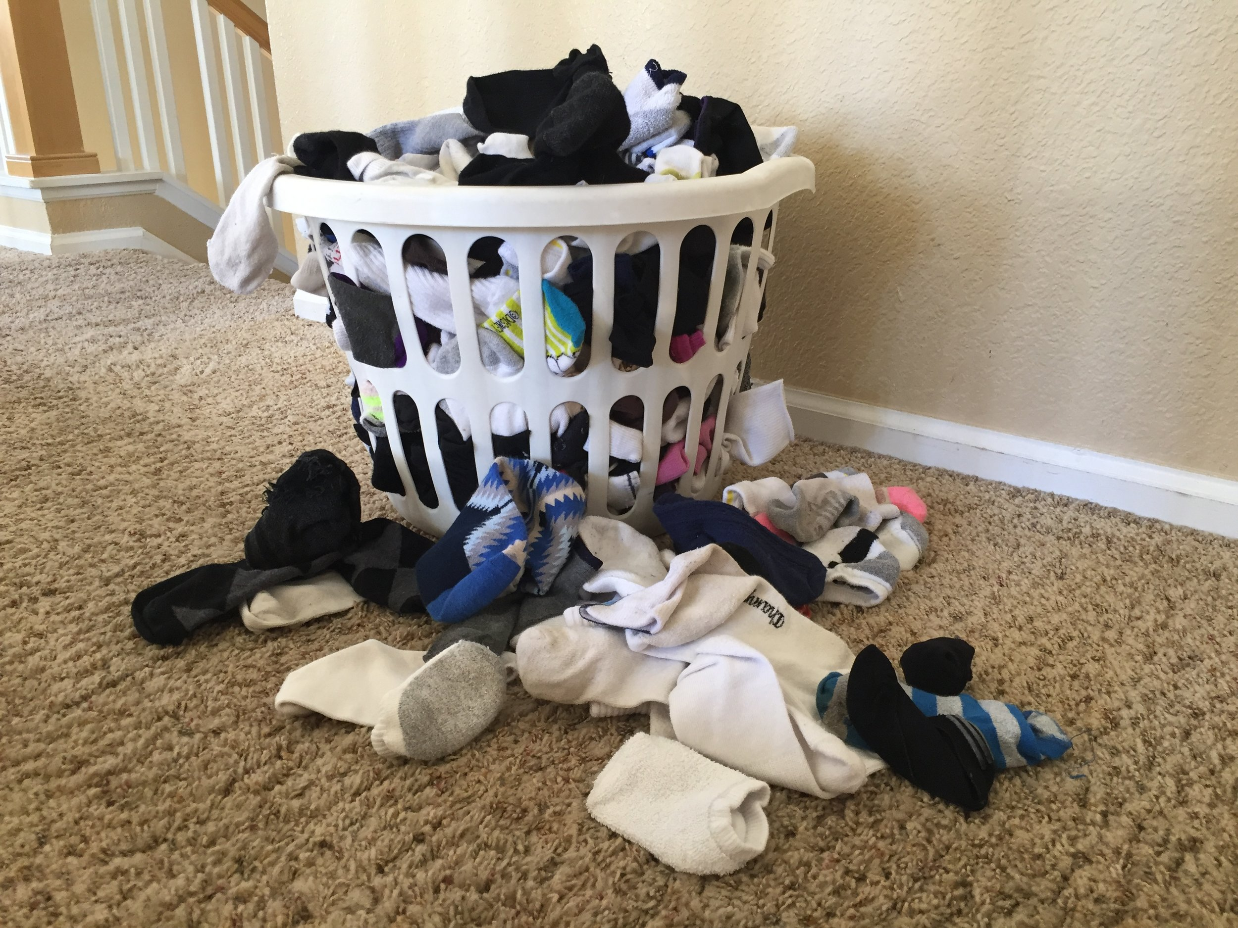 Molly  pays her kids $1 for every ten socks they sort and put away.