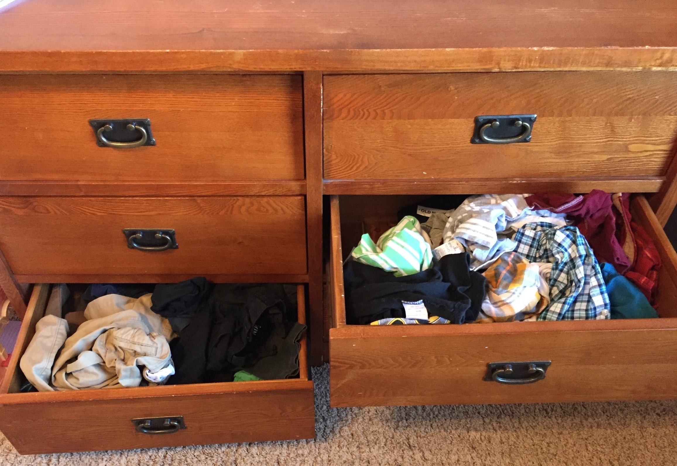 Molly  stopped folding her kids' play clothes, because the drawers just get messed up anyway. She still hangs school uniforms and church clothes.
