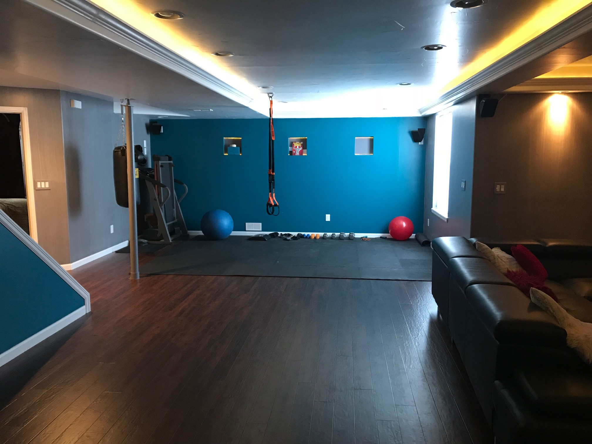 We left the rest open to entertain guests for parties and watch movies. There is a foosball table, long bar for projects, electronic dart board, micro sized ping pong, cupboard full of board games, a punching bag, a fitness pole and hanging bands, a giant balance ball and a stairway without a railing for sliding down.