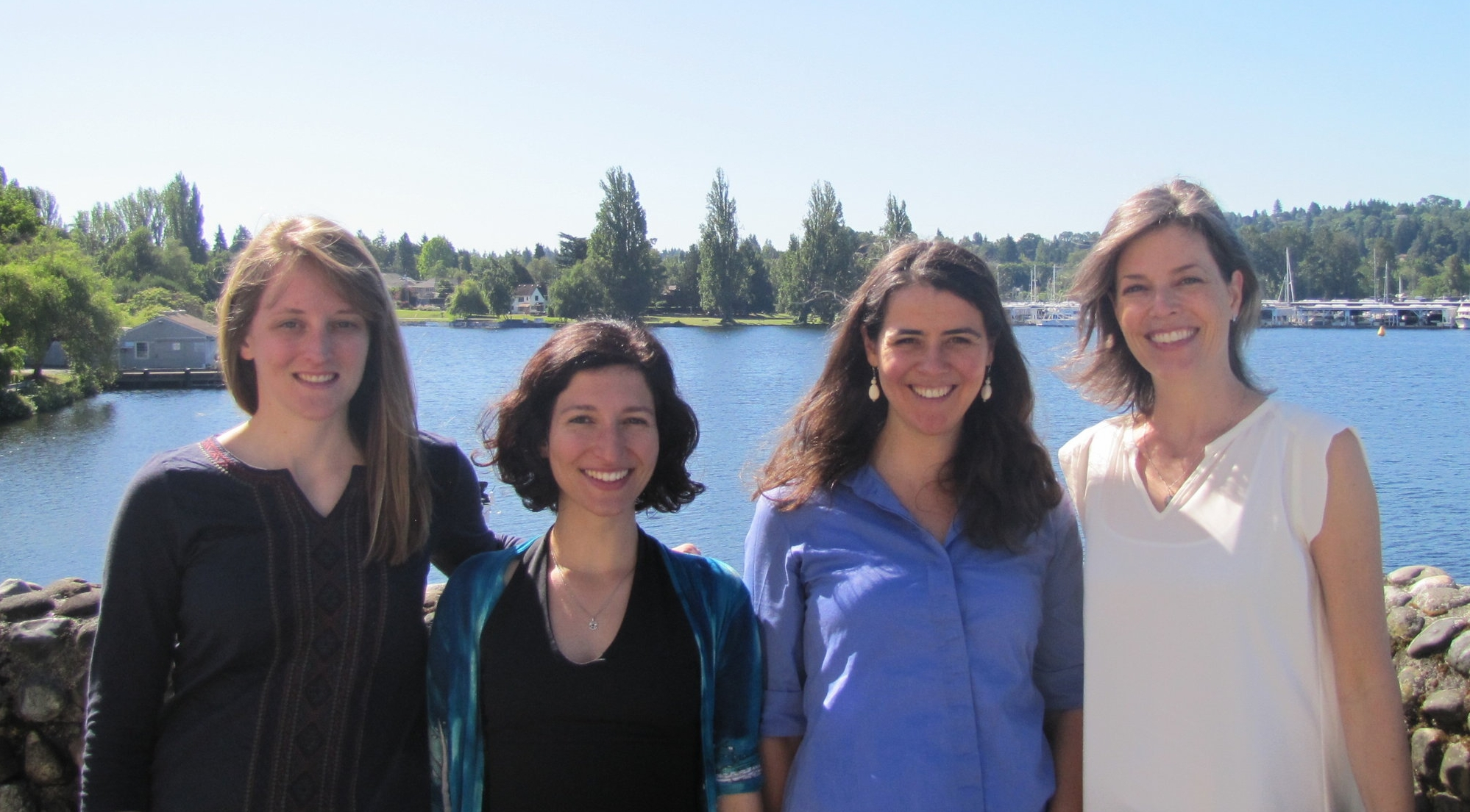 Collaborating on the UW waterfront. Student authors from left to right: Hillary Scannell (Oceanography), Eleni Petrou (Aquatic and Fishery Sciences), Leah Johnson (Oceanography), Katherine Crosman (Public Policy and Governance)