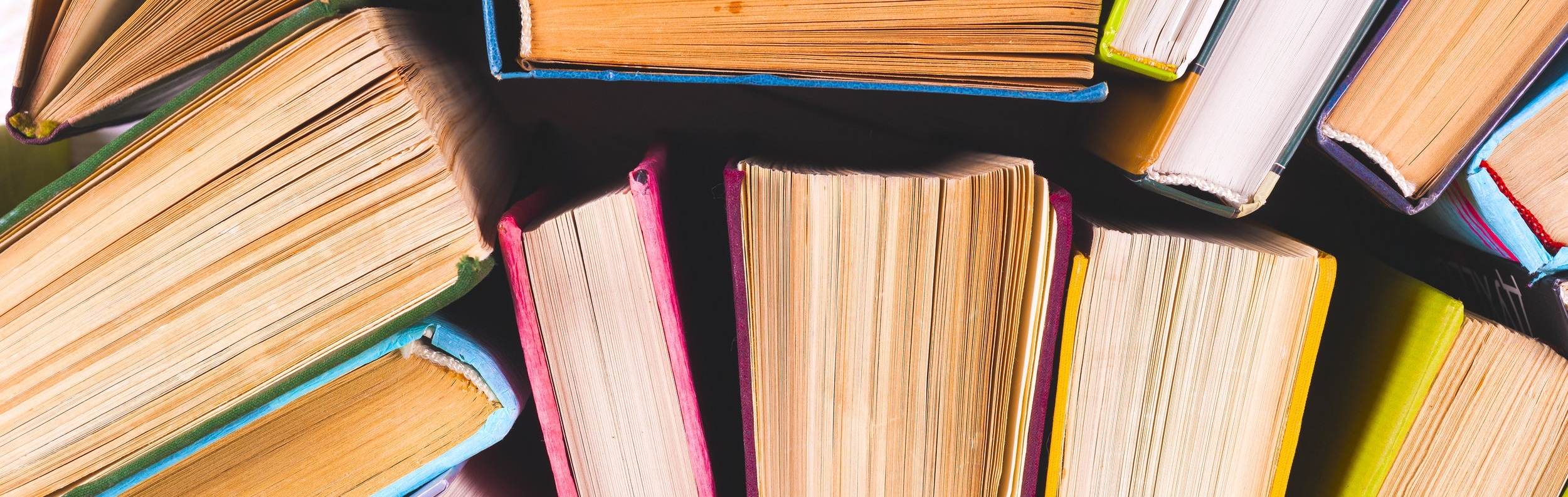 bigstock-Open-Book-Hardback-Books-On-B-228239119.jpg