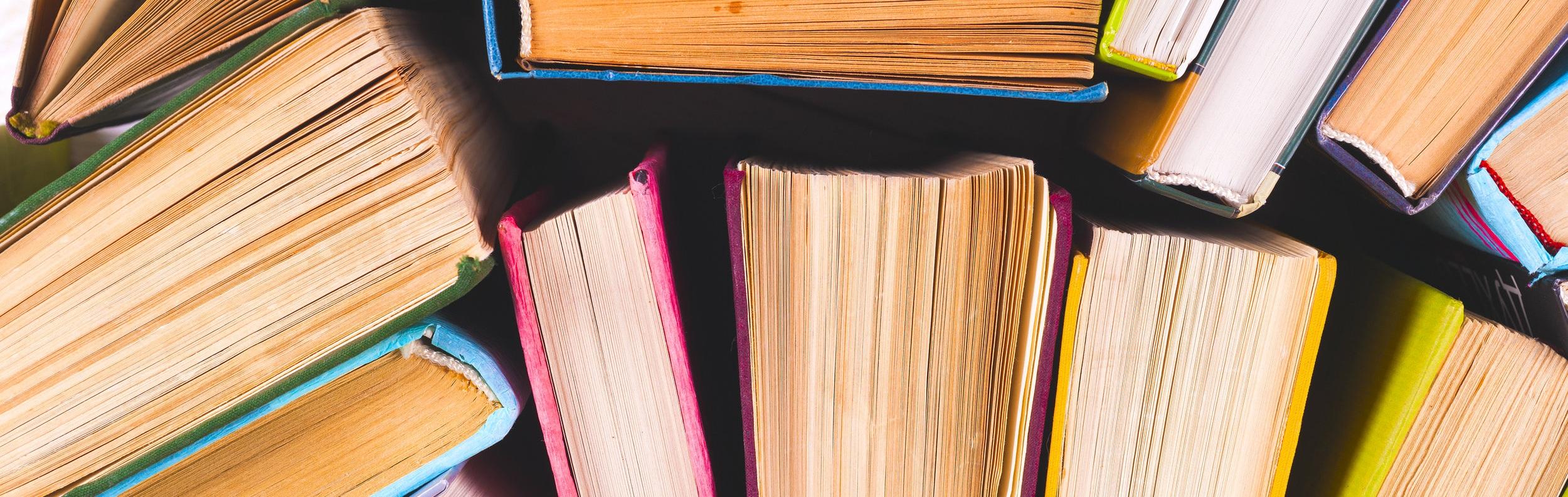 bigstock-Open-Book-Hardback-Books-On-B-228239119-1.jpg