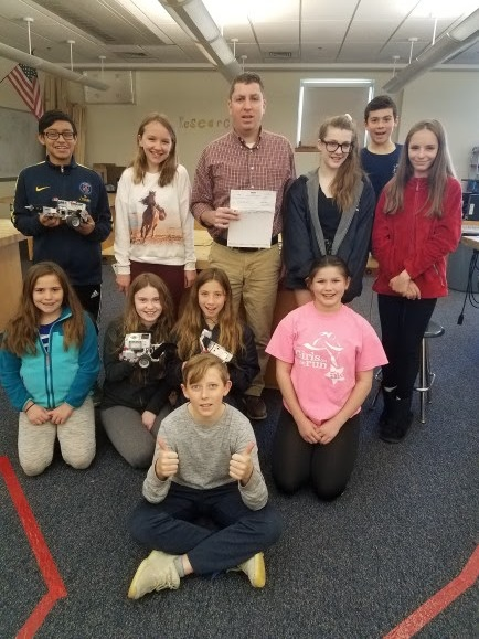 Memorial Middle School recently received a $5,000 Lowe's Toolbox for Education grant to create a makerspace. Back row, left to right: Dillon Simpson-Sliney, Kaelyn Burke, Brandon Sullivan, Hailey Putnam-Resnick, Oliver Szabo and Meghan McDonald. Second row, left to right: Emma Driscoll, Tallula Clancy, Aalina Colon-Silverman and Marie Marois. Front row: Max Day. (Courtesy Photo Hull Public Schools)