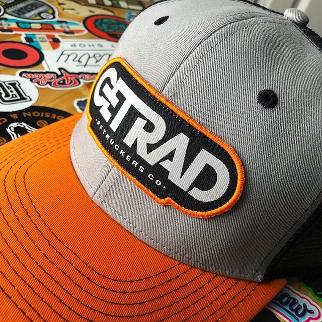 It's Friday and that can only mean one thing... it's time to #getrad. Pictured here is our official get rad mesh trucker. Fiery Sun Orange bill, Seattle Gray face and Black Flag black mesh. Grab one at the link in our bio!
