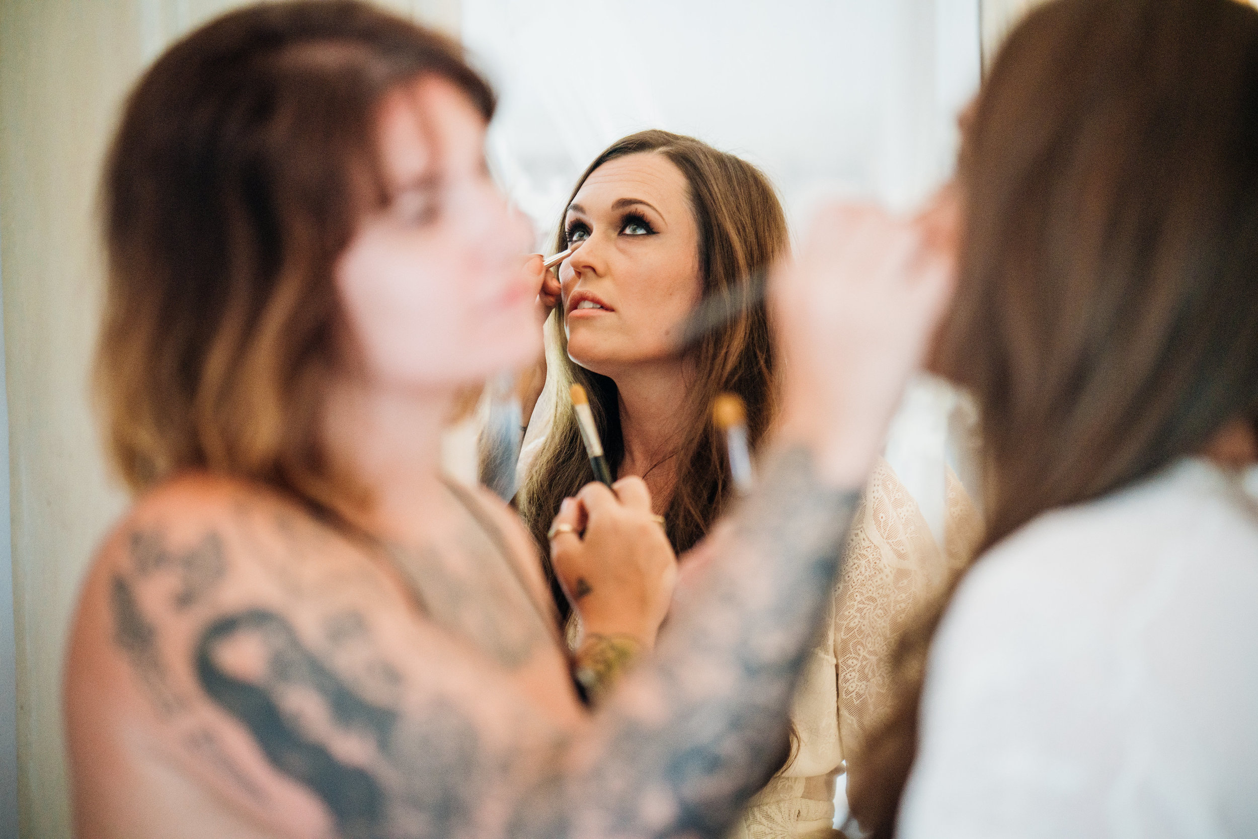 Bride getting ready with smokey eye abigail steed photography