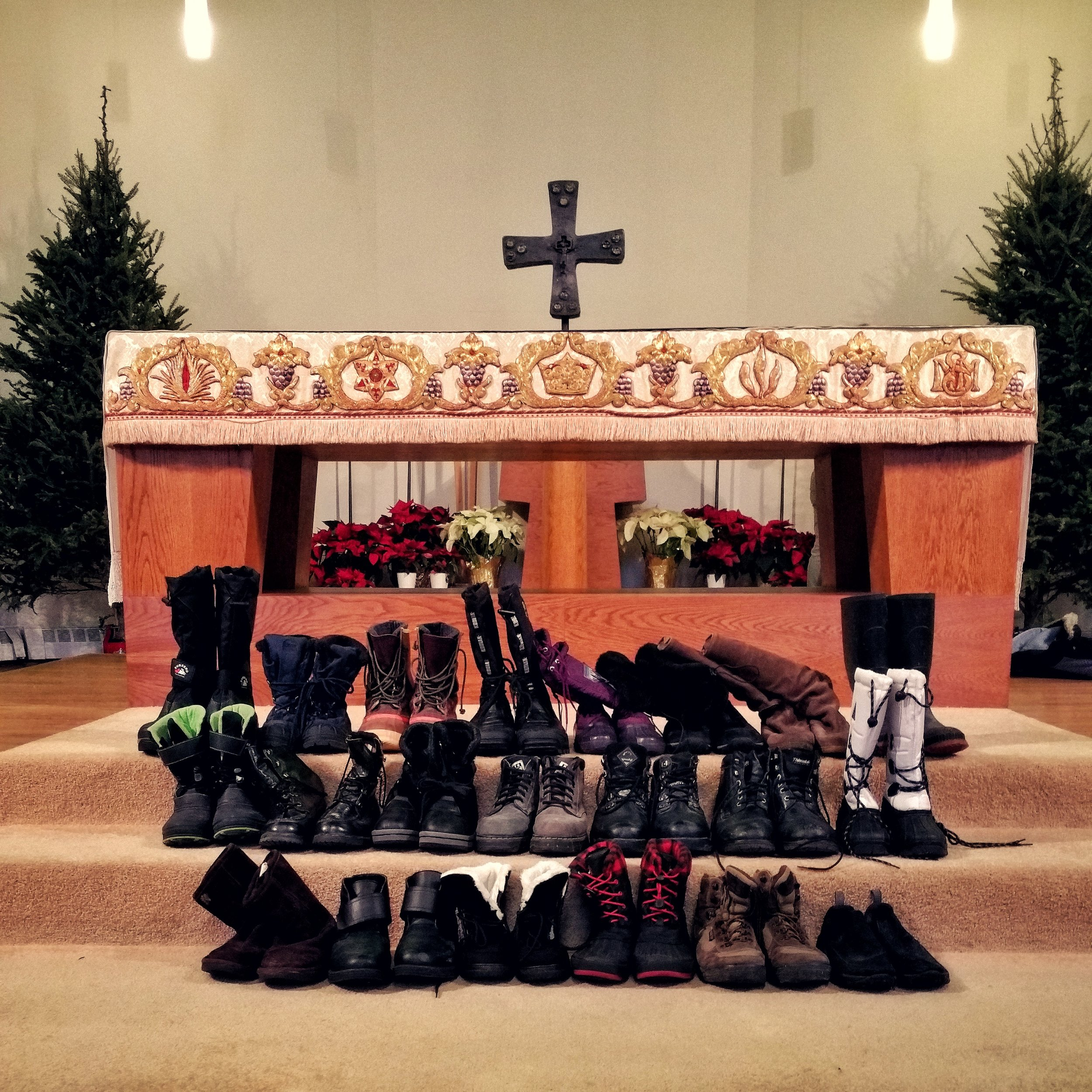 The boots we collected in this year's Boot Drive, before the altar at SMM.