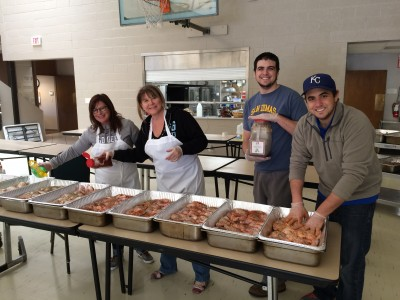 Triune family members prepare the meal at Reconciliation Services