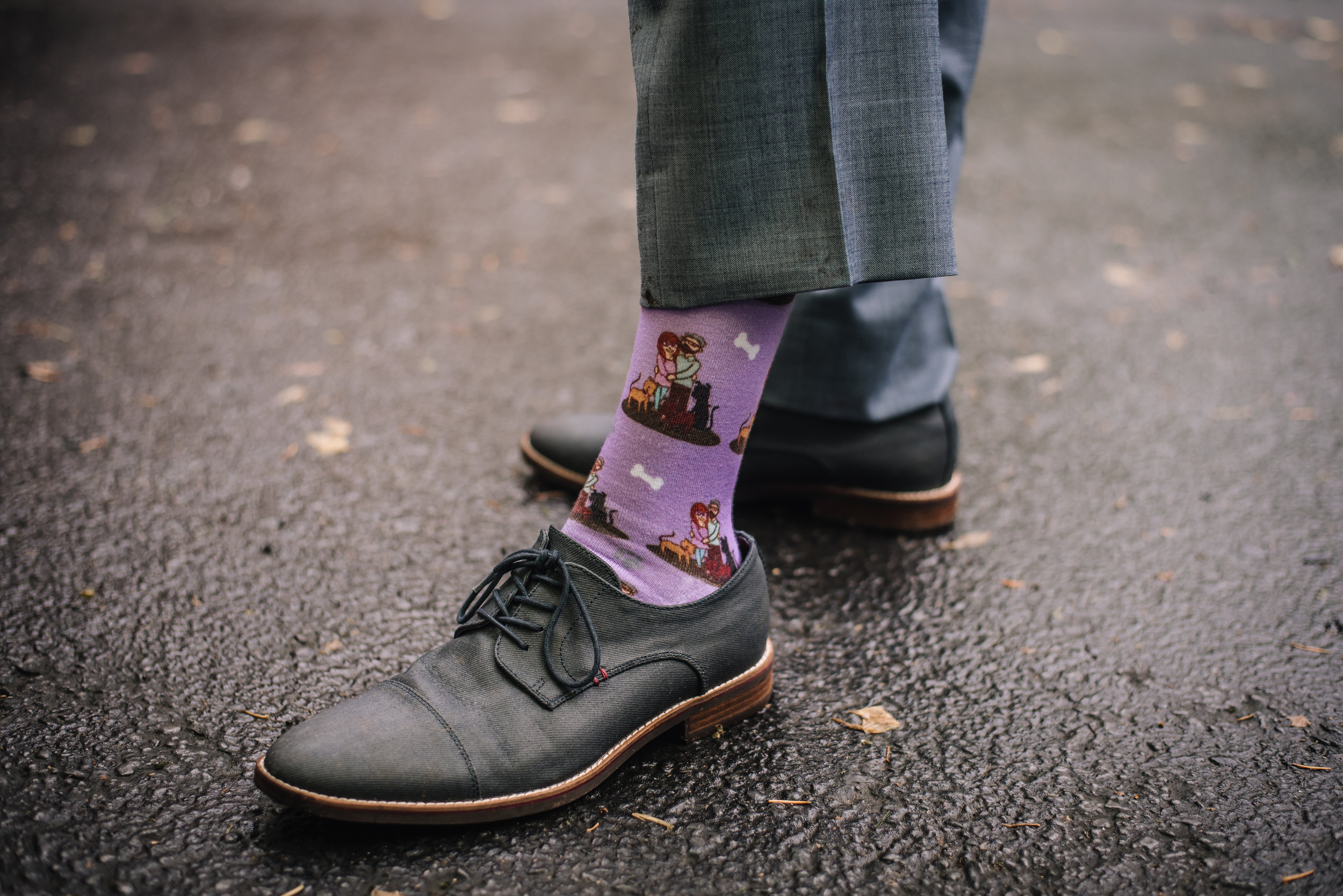 How cool are these custom socks Sarah got Christian picturing them and their 3 dogs!?