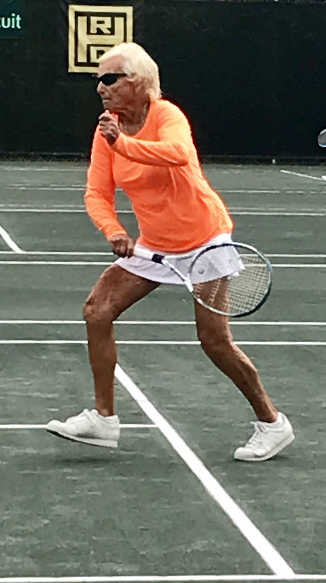Jane Lutz approaching the net at the Women's Clay Court National in Houston