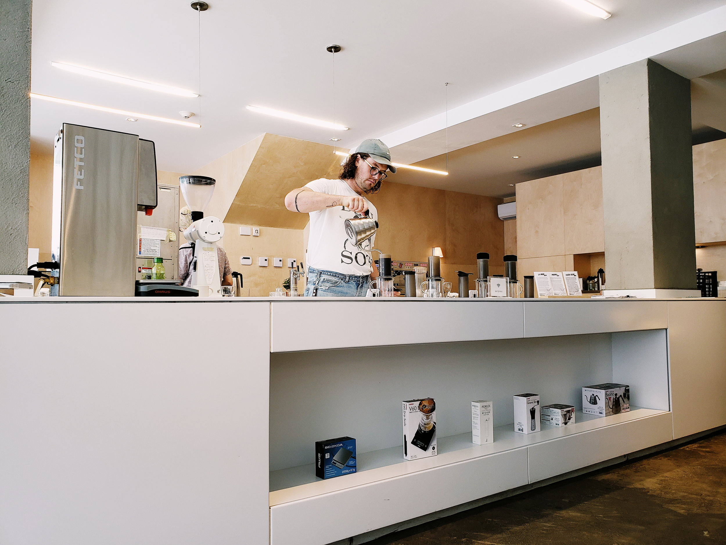 Our barista brewing our coffee with Aeropress at Dispatch.