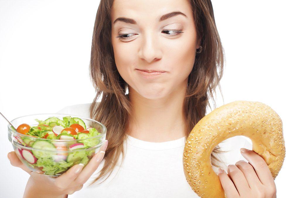 Woman-choosing-bowl-of-salad-over-bagel-1000x675.jpg