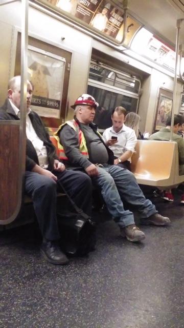 MAN IN A SUBWAY CAR -