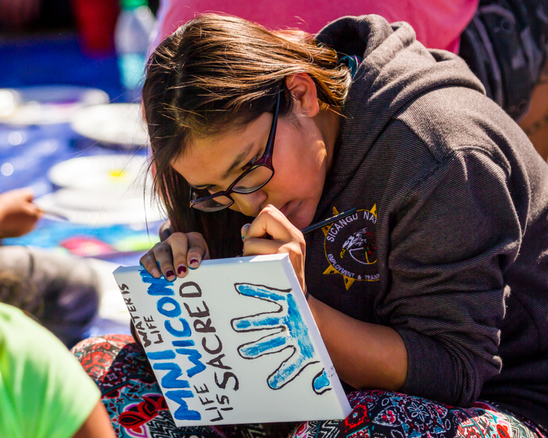 """""""Young Water Protector"""" September 17th, 2016 at Oceti Sakowin on the Standing Rock Sioux Reservation near Cannonball, ND"""