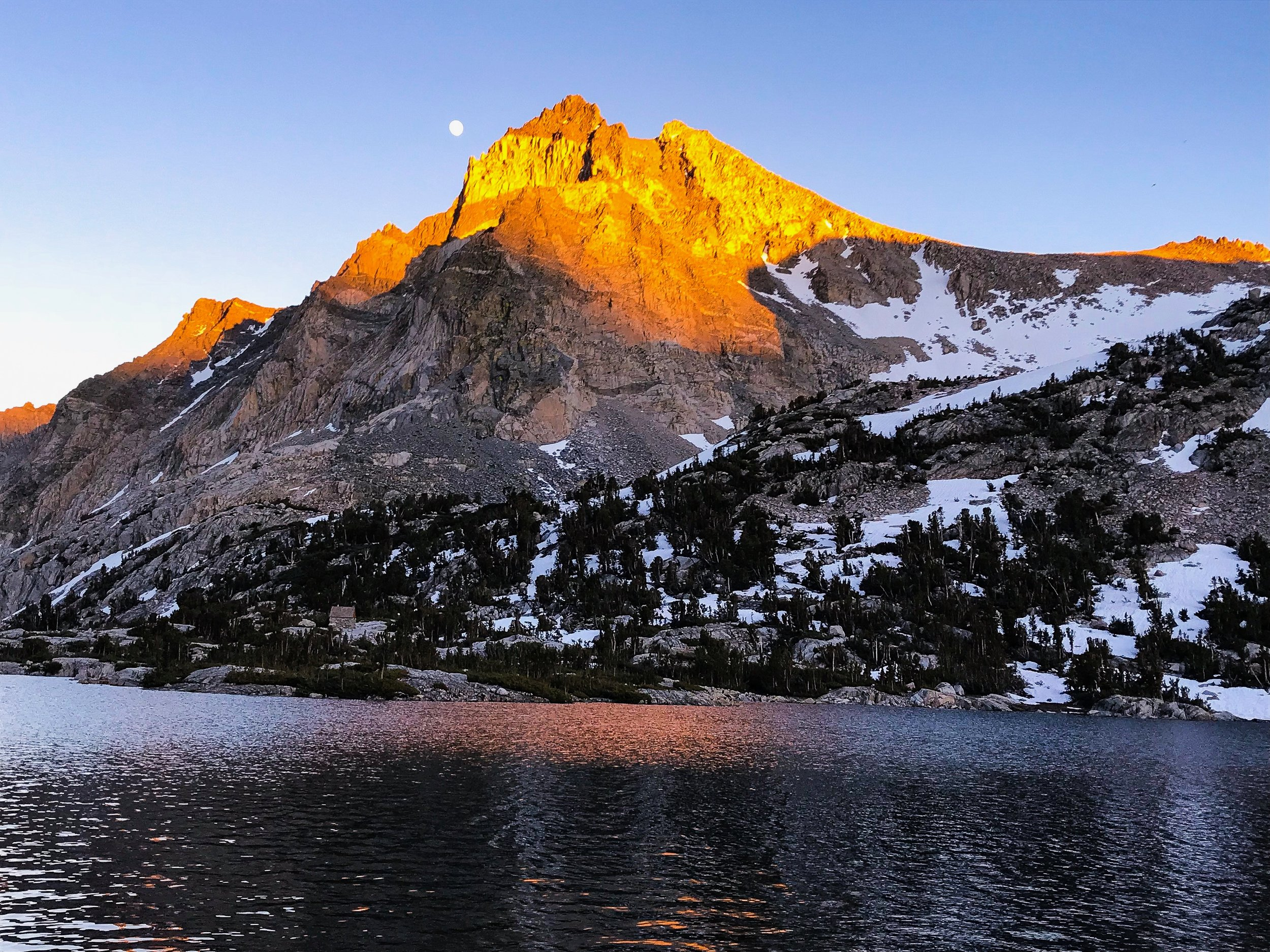 A stunning alpine lake at sunset