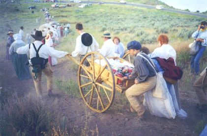 Made July 20, 1997 on a hill just north of East Canyon reservoir, East Canyon, Utah. This scene depicts, Handcart Struggles.  Photograph by Steve Berlin.  This handcart was made in Russia, pulled across Siberia and Ukraine and flown from Moscow to Salt Lake City for the final leg of the trek. It bears gifts made by members of the LDS Church in several Slavic countries for the church president. East Canyon Reservoir is seen in the upper right.