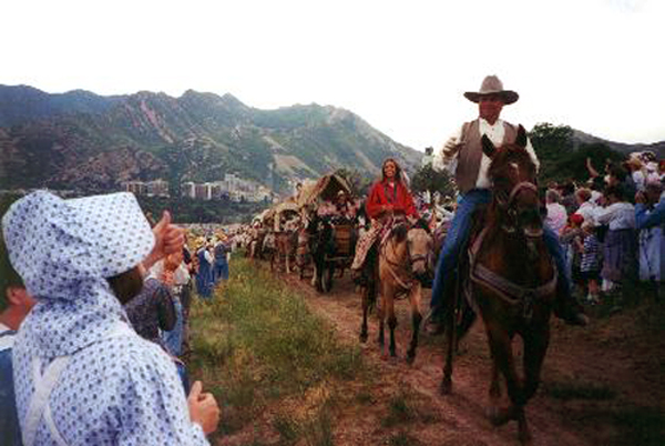 Made July 24, 1997 at the Place State Park, Salt Lake City, Utah. Triumphal Entry - 50,000 Greeters.  Photograph by Steve Berlin.  A throng of more than 50,000 cheering, enthusiastic greeters welcomed the re-enactment company as it entered the Salt Lake Valley after nearly 100 days travel over 1100 miles along the Mormon Trail from Winter Quarters, Nebraska to Salt Lake City.