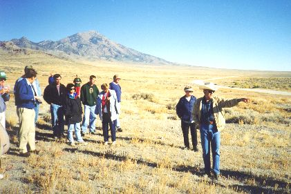 3. Made 10/18/97 at Crossroads kiosk site, ~20 miles North of Wendover, UT. A  lso Hastings Road. Photograph by Steve Berlin.  View looking north, Pilot Peak in the background. Al Mulder, at the site of the coming Utah Crossroads Chapter interpretive kiosk, points to important trail landmarks including nearby Bidwell pass.