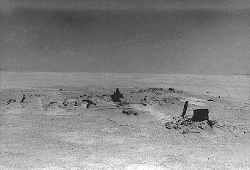 1 8. Made 1929, Great Salt Desert, Utah.Abandoned Wagon Historical Photograph.   Used by permission, Utah State Historical Society, all rights reserved - Photograph: Charles Kelly.   This picture of the remains of an abandoned wagon was made by Charles Kelly, early trail enthusiast and self-taught historian and researcher. The black object on the right is the hub from an unusually large wagon wheel and Kelly took this to be James Reed's oversized wagon. The picture appears as Figure 11 on page xxvi of the 1996 edition of Kelly's 1930 book  (Salt Desert Trails, Peter H. DeLafosse ed. Salt Lake City: 1996).